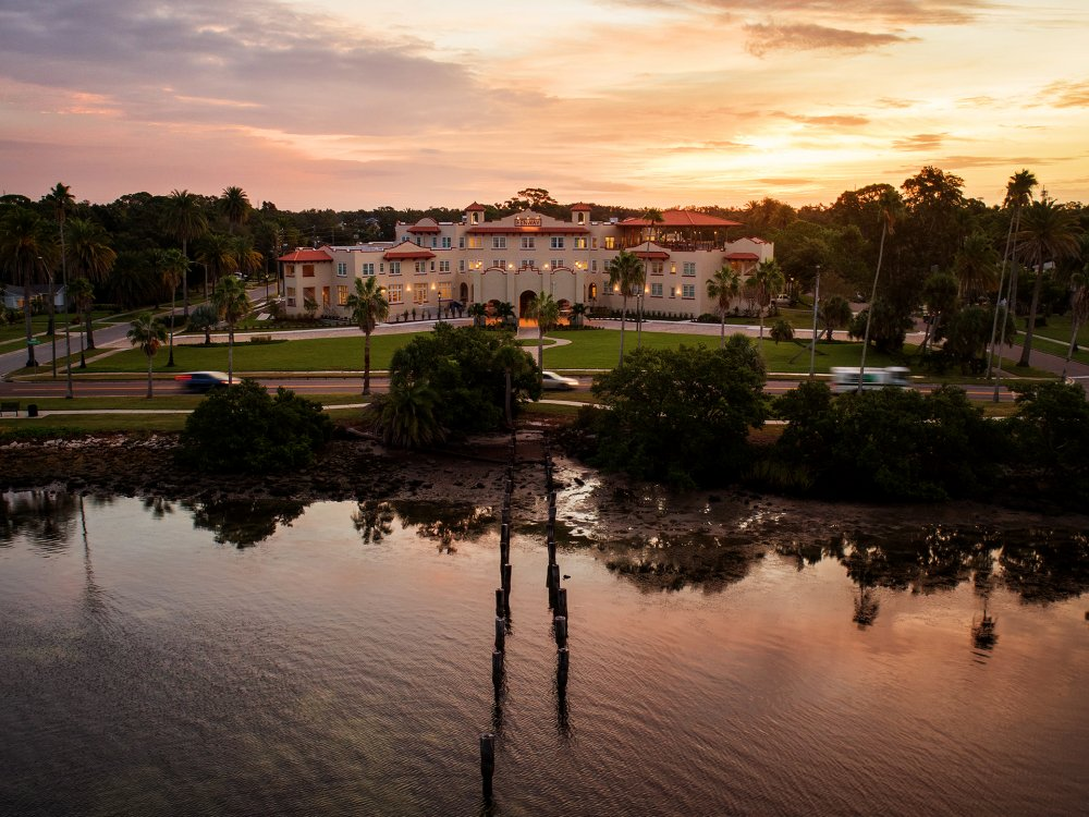 An aerial view of the waterfront at Fenway hotel in Dunedin at sunrise