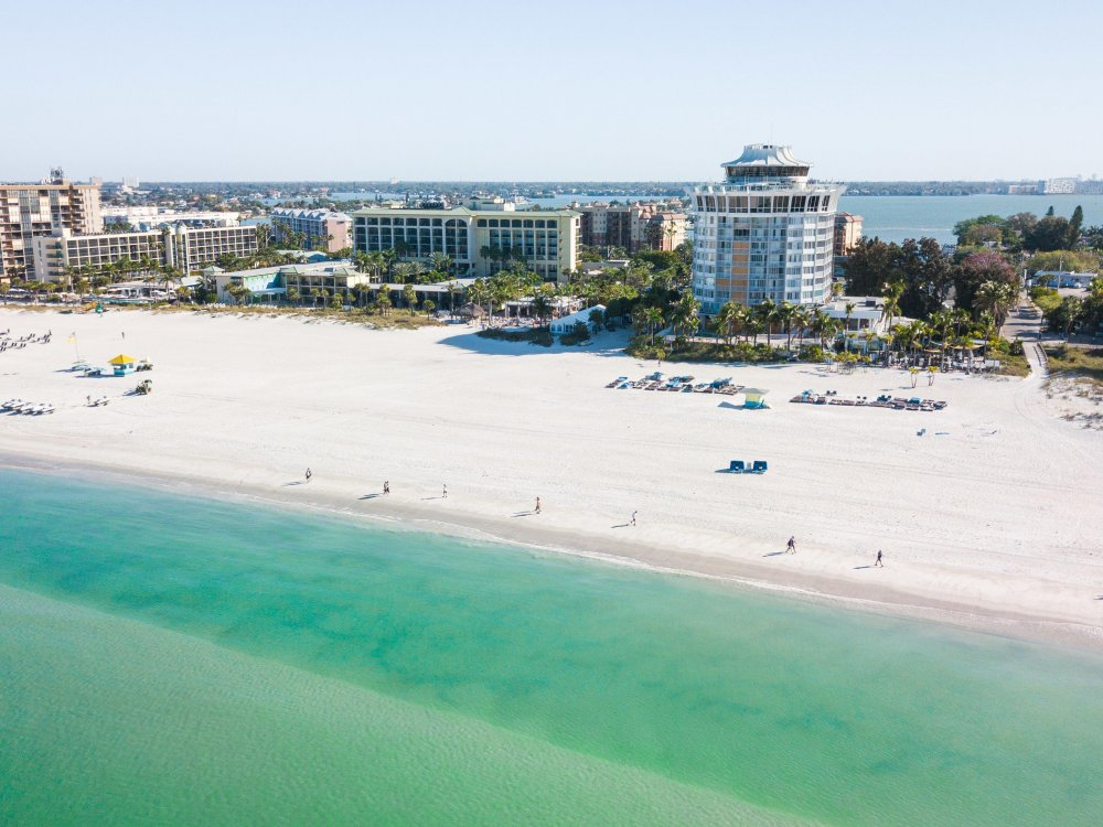 Aerial view of St. Pete Beach emerald-green waters with Bellwether Beach Resort in the background